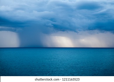 Dark and Dramatic blue sky and  blue sea color and dark storm raining cloud background