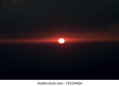 dark dramatic clouds at sunset