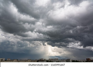 Dark dramatic sky with a stormy gray clouds just before storm - nature photography. The rain is coming soon. Pattern of the clouds over city. Heavy clouds but no rain.