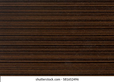 Dark ebony veneer, natural wooden background on macro. Extremely high resolution photo.