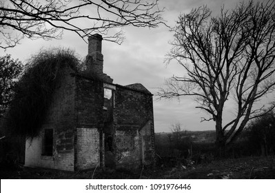 Dark eerie derelict house in Black and White