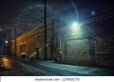 Dark and eerie industrial urban city street at night in Chicago