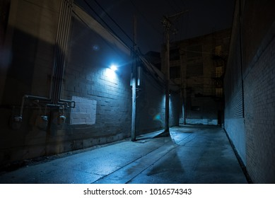 Dark and eerie urban city alley at night.