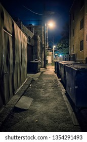 Dark and eerie urban city alley at night in Chicago