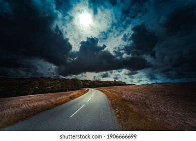 Dark empty road before the storm