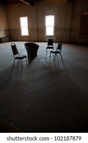 Dark empty room with two windows with chairs