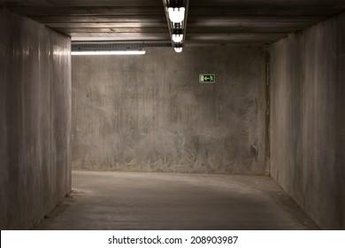Dark empty underground passage tunnel made from concrete