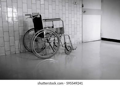 Dark Empty wheelchair parked in hospital