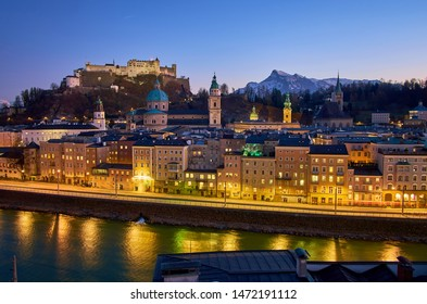 The dark evening sky over old Salzburg gives the illuminated streets even more magical charm, Austria