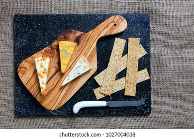 Dark Food - Blue Stiltons and Blue Shropshire cheeses on an olive wood board - overhead