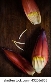 Dark food photography with banana flower on wooden background. thai food.