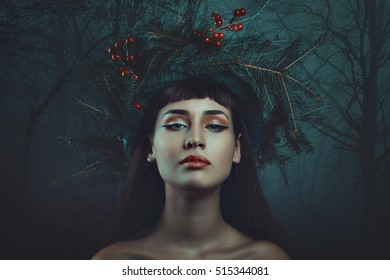 Dark forest winter portrait of a beautiful woman. Fantasy and surreal
