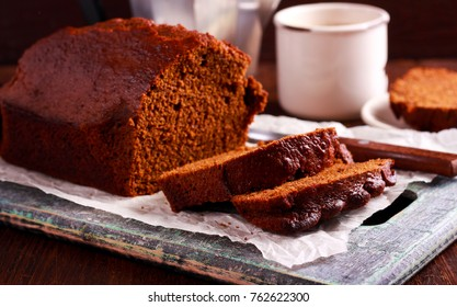 Dark ginger loaf bread, sliced on table