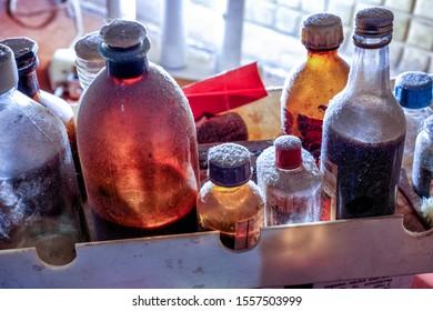 dark glass vintage bottles in mystery lab
