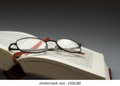 dark glasses on a book close up