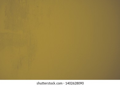 Dark golden plastered with rough structures concrete wall in industrial design. Creative element in pastel colors as background and for artistic collages. Structure wall in portrait format.