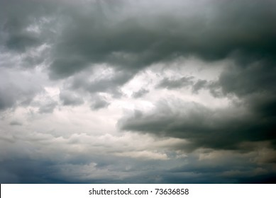 dark gray dramatic sky with large clouds
