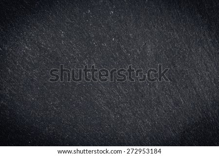 Dark gray granite texture or background with vignette