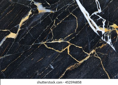 dark gray Marble with beautiful patterned white and gold texture for design. abstract background.