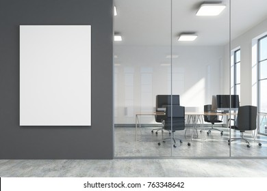 Dark gray office lobby with a concrete floor, loft windows and a glass wall. There is a large vertical poster and a meeting room. 3d rendering mock up
