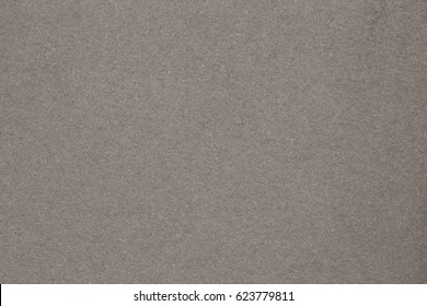 Dark gray paper texture with abstract pattern.