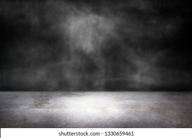 Dark gray wall with a concrete floor