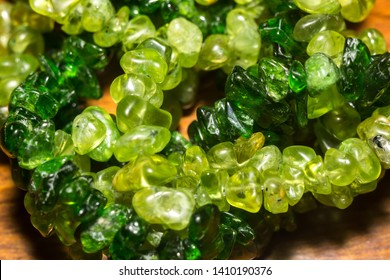 Dark green chrome diopside and olive green peridot, natural stone gravel close up.