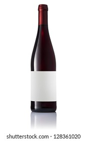 Dark green glass bottle with red wine with label isolated on a white background.