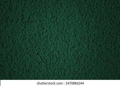 Dark green stucco wall texture as background