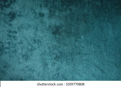Dark green velvet fabric surface from above