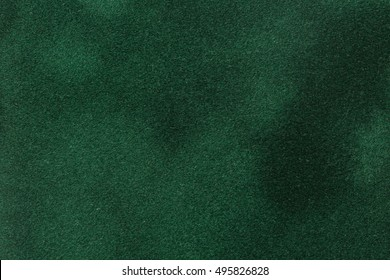 Dark green velvet paper for background. High quality image.
