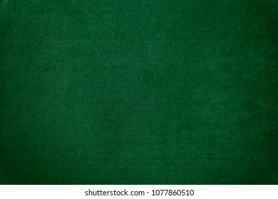 Dark green velvet texture background. Green velvet fabric