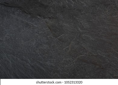 Dark grey black slate background or texture