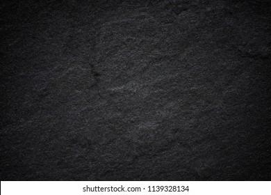Dark grey black slate background or natural stone texture.