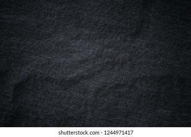 Dark grey black slate background or natural stone texture. Black stone wall.