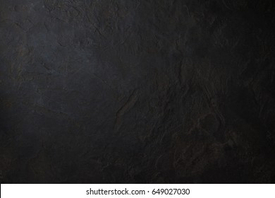 Dark grey black slate background or texture. Abstract Black stone background.