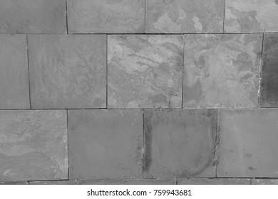 Dark grey black slate background or texture. Stone wall background.