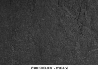 Dark grey black slate background or texture. Surface stone wall.