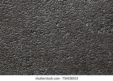 Dark grey black stone background or texture.