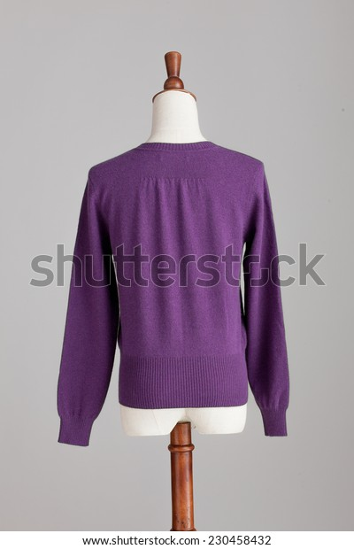 dark grey cashmere sweater with wood model on grey isolated