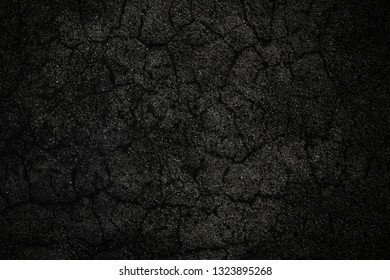 Dark grey craked wall background or texture