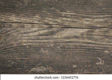 Dark grey extreme distressed weathered wood texture.