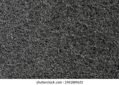 Dark grey filamentous texture and background. Sponge filamentous structure, macro close-up background.