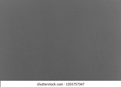 Dark grey paper with small granular texture