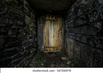 Dark grey stone walls leading to a spooky wooden door. & Spooky Door Images Stock Photos \u0026 Vectors | Shutterstock