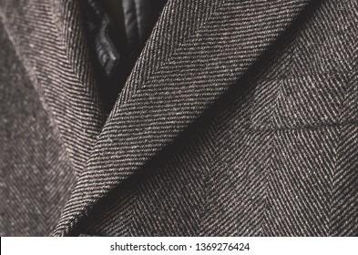 Dark grey tweed coat close up