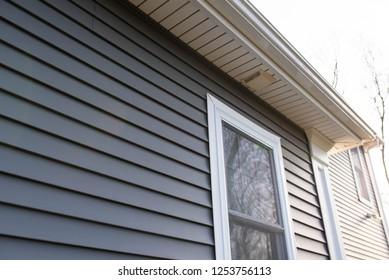dark grey vinyl siding on new home