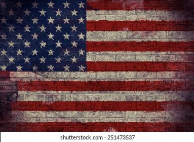 Dark Grunge American Flag on an old Brick Wall