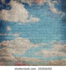 Dark Grunge image of a Blue Sky with Clouds painted on a Brick wall