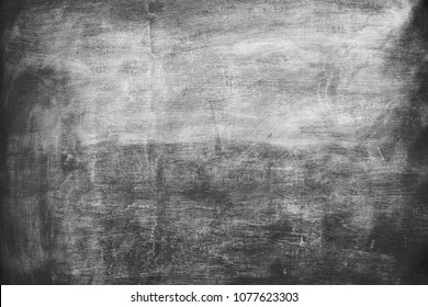 Dark and grungy concrete wall texture with retro faded look